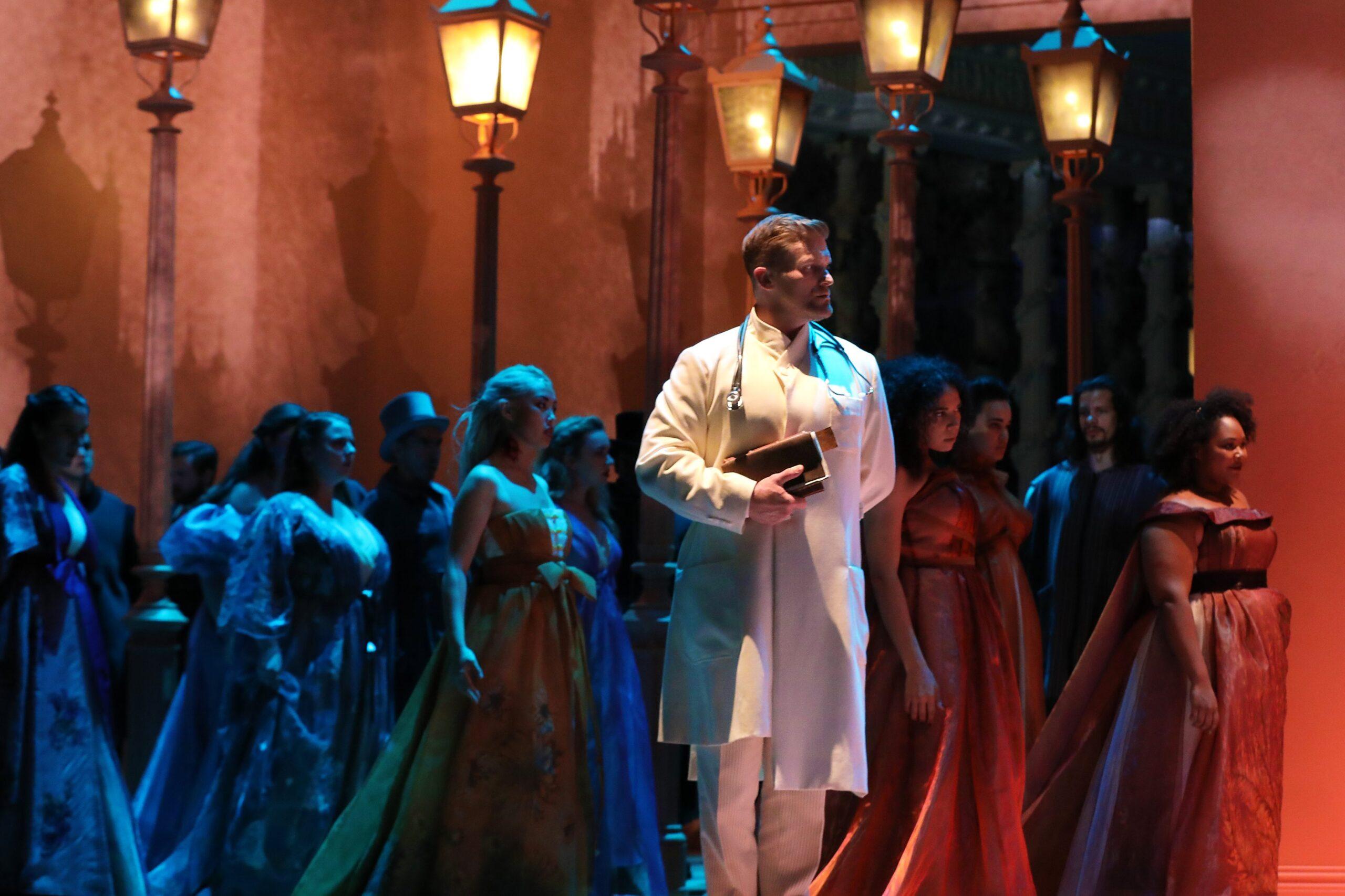 Jarrett Ott (John Seward) and the Santa Fe Opera Chorus. Photo Credit: Curtis Brown for the Santa Fe Opera, 2021